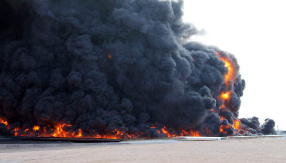 Smoke rising from a large fuel depot fire at al-Sidra, Libya, during fighting