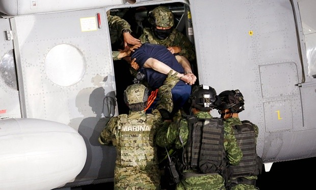"""Soldiers escort drug lord El Chapo into a helicopter in Mexico City. Photograph: Tomas Bravo/Reuters He was so serious about a movie that he attempted to contact producers and actresses through intermediaries after escaping, Gómez said Friday night, before his perp walk at the Mexico City airport. Those attempts came to the attention of the authorities, letting them know that he had returned to his old haunts in the rugged Sierra Madre – an area so impenetrable, it has been compared to the Tora Bora caves of Afghanistan. """"He established communication with actors and producers, which formed a new line of investigation,"""" Gómez said. Investigators, she added, tracked the movements of Chapo's lawyers and their meetings with potential participants in a biopic. She didn't divulge names or any possible actors, however. Nor did she take questions. Movies about narcotics trafficking and Mexico's war on drugs have started appearing in Mexican theatres in recent years – with many receiving critical acclaim. The movies arrived after the government cracked down on drug cartels and violence escalated – to the point it has claimed more than 100,000 lives since 2006. Ironically, a film titled The Great Escape – on El Chapo's life and most recent vanishing act – was set to open in cinemas on 15 January. """"It will be a series of four pictures that will tell the life story of El Chapo in reverse,"""" Carlos Olivares, a representative of the film's distributor, told the newspaper Excélsior. """"The first deals with his escape, his human side and the political situation of Mexico."""" Advertisement Truth proved stranger than fiction, however. And not everyone was buying what the government said about El Chapo's big plans for a biopic. """"Why would a drug lord call attention upon himself when he is hiding? It makes no sense,"""" said Rodolfo Soriano Nuñez, a sociologist in Mexico City and social observer. The government, he added, """"seem to be unaware of how hard it is to believe them"""". Guzmán's capture"""