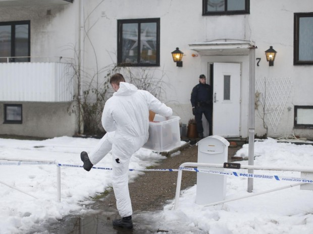 Police investigators are seen outside a home for juvenile asylum seekers in Molndal in south western Sweden on January 25, 2016 AFP/Getty Images