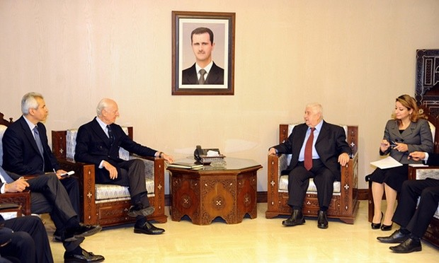 Syria's foreign minister Walid al-Moallem, second right, meets UN special envoy Staffan de Mistura, second left, in Damascus. Photograph: Uncredited/AP
