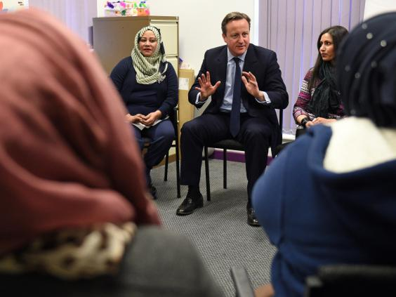 David Cameron speaks with women attending an English language class during a visit to the Shantona Women's Centre in Leeds Getty