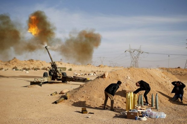 Militia fighters aligned with the forces that took over the government in Tripoli, Libya, fired an artillery piece at Islamic State militants near Surt last year. Credit Goran Tomasevic/Reuters