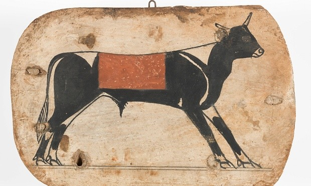 A foot board of an Apis bull from an Egyptian cartonnage coffin, from 745- 655 BC.  Photograph: Jaymes Sinclair/The Fitzwilliam Museum