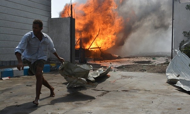 The aftermath of an airstrike in Al Hudaydah, Yemen, which Ban Ki-moon said was 'in flames' from bombing. Photograph: Abduljabbar Zeyad/Reuters