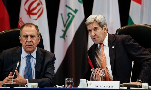 The Russian foreign minister, Sergei Lavrov, and the US secretary of state, John Kerry, at the talks in Munich. Photograph: Alexander Shcherbak/TASS