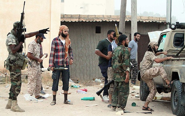 Libya Dawn militants prepare to fire a rocket-propelled grenade in the Wershfana region of Tripoli Photo: Xinhua/Barcroft