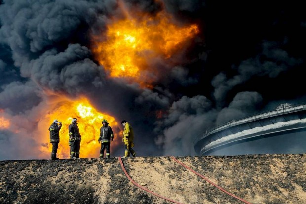 Firefighters battled a blaze at an oil tank in the Libyan port city of Es Sider during a series of attacks last month on the country's oil industry by Islamic State extremists. Photo: Reuters