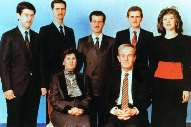 In this picture, taken around 1990, Syrian President Hafez al-Assad and his wife Anisa pose with their children (L-R) Maher, Bashar, Bassel, who died in a car accident in 1994, Majd and Bushra | Getty Images