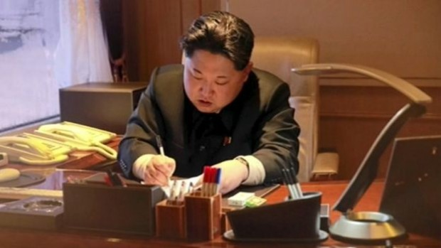 Kim Jong-un is shown signing-off on the rocket launch | Reuters