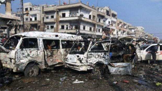 Images from Homs released by state media showed streets filled with debris and mangled cars | AP