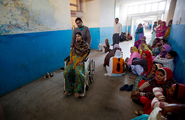 A woman was wheeled from an operating room after having sterilization surgery this month at a government hospital in Mahendragarh, India. Kuni Takahashi for The New York Times