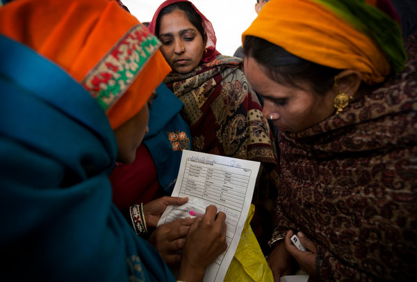 A woman filling out a consent form for sterilization surgery. India funds about four million tubal ligations every year. Kuni Takahashi for The New York Times