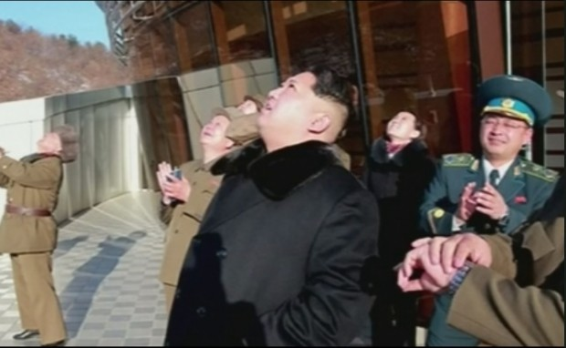 Kim Jong UN watches the launch