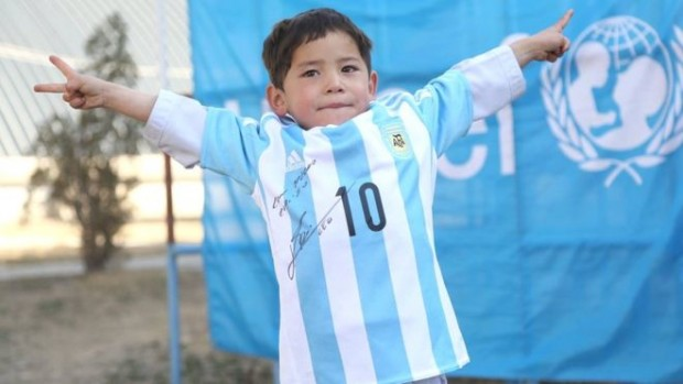 Murtaza Ahmadi wearing his signed Lionel Messi Argentina shirt