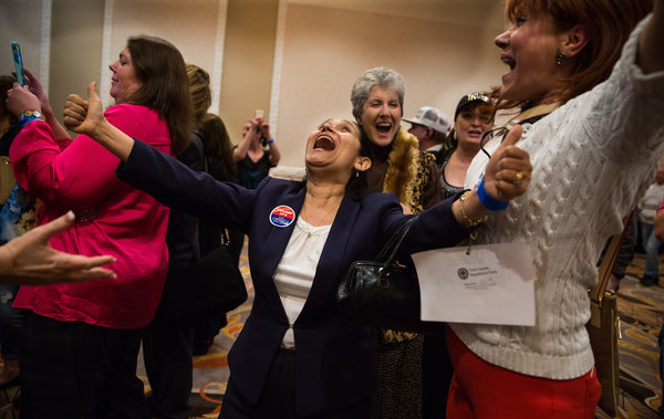 Attendees cheered after hearing the Nevada caucus results at Donald J. Trump's watch party in Las Vegas on Tuesday night. Credit Ruth Fremson/The New York Times