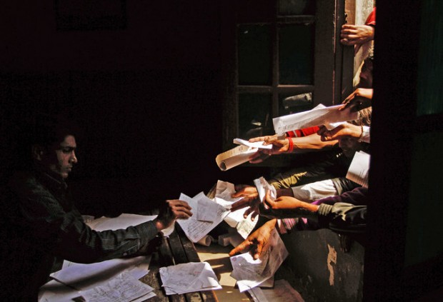 Unemployed Indians handed in paperwork at a government employment office in 2012. Credit Rajesh Kumar Singh/Associated Press