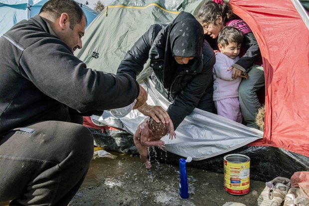 Refugees wash the baby born in a tent at the Idomeni refugee camp near the Greece-Macedonia border. Photograph: Anadolu Agency/Getty Images