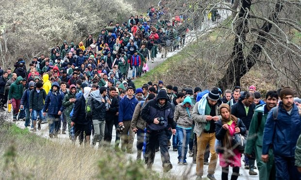 More than a thousand people walk from a camp near the Greek village of Idomeni as they try to find an alternative way to cross the border between Greece and Macedonia. Photograph: Nake Batev/EPA