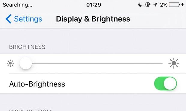 iOS brightness adjustment. Photograph: Samuel Gibbs for the Guardian