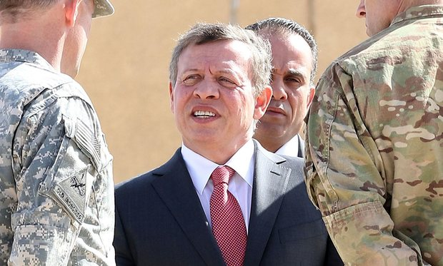 King Abdullah speaks to military personnel at a joint training centre in Zarqa, north-east Jordan. Photograph: Khalil Mazraawi/AFP/Getty Images