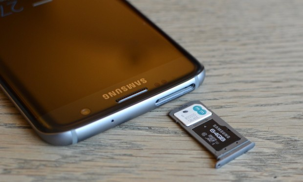 The microSD card slots into the same tray as the nanosim. Photograph: Samuel Gibbs for the Guardian