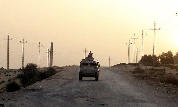 An Egyptian military vehicle on the road in Sinai. Isis has claimed responsibility for the attack on a security checkpoint in the area that killed at least 13. Photograph: Asmaa Waguih/Reuters