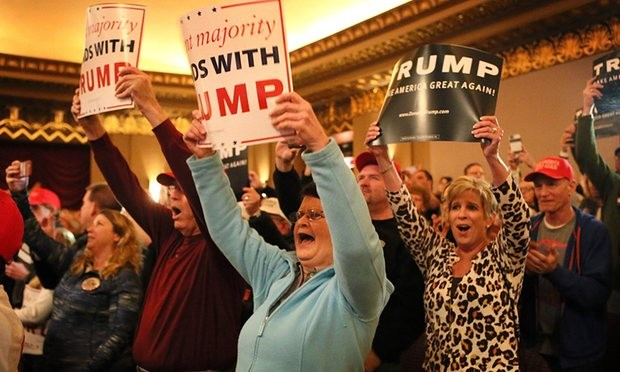 Trump supporters cheer during a campaign rally at the Peabody Opera House in St Louis. Photograph: St Louis Post-Dispatch/REX/Shutterstock