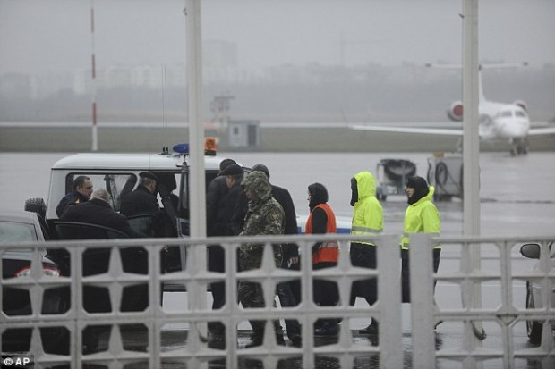 Russian Emergency Situations Ministry employees and police officers are seen as they take a car to drive to the area of a plane crash that killed 62 people at the Rostov-on-Don airport Saturday