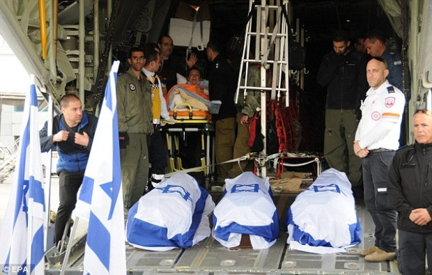The bodies of three of the victims of the attack were being flown back to Israel today