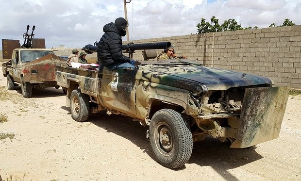 Forces loyal to Libya's eastern government in clashes in Benghazi with Islamist group Ansar al-Sharia. Photograph: Reuters
