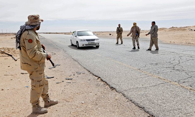 Libyan soldiers at a military outpost west of the city of Sirte, Isis's stronghold in the country. Photograph: Ismail Zetouni/Reuters