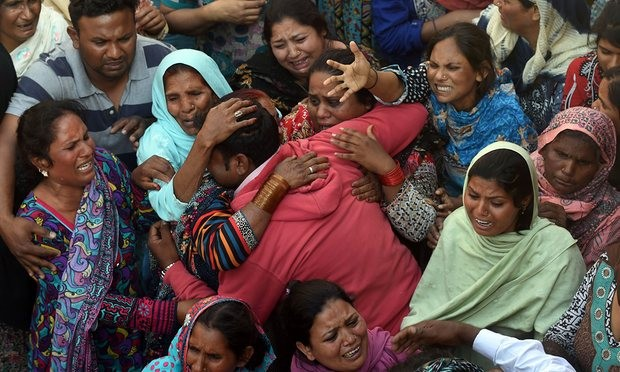 Pakistani Christians mourn at a funeral for a victim of the Easter Sunday suicide bombing in Lahore. Photograph: Arif Ali/AFP/Getty Images