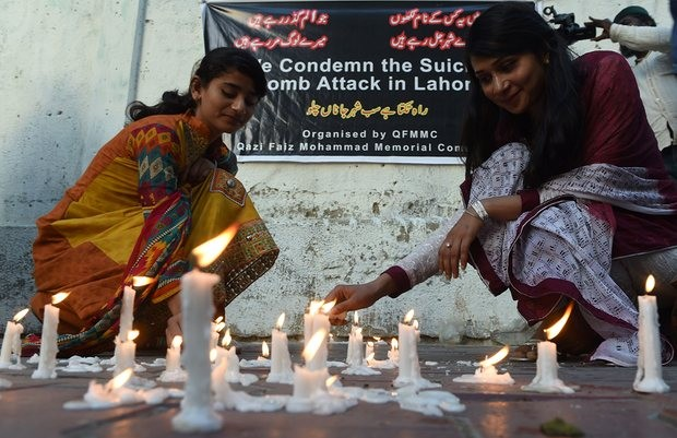 Karachi residents light candles to pay tribute to the victims of the 27 March suicide bombing in Lahore. Photograph: Asif Hassan/AFP/Getty Images
