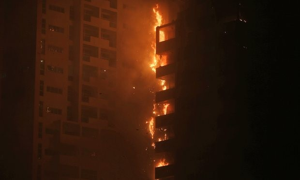 Fire and smoke billow from the high-rise building in Ajman. Photograph: Kamran Jebreili/AP