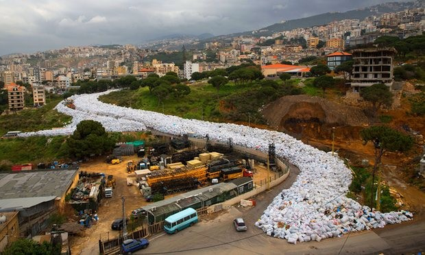 Packed rubbish bags fill a street in Jdeideh, east Beirut. Residents have joked that it resembles one of Lebanon's ski slopes. Photograph: Hassan Ammar/AP