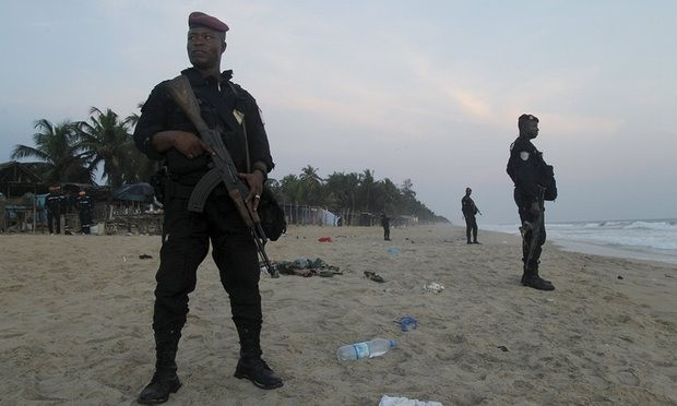 Soldiers stand in guard on the beach in Grand Bassam. Photograph: Luc Gnago/Reuters