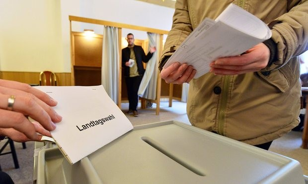 Germans cast their ballots in Stößen, Saxony-Anhalt. Photograph: Martin Schutt/EPA