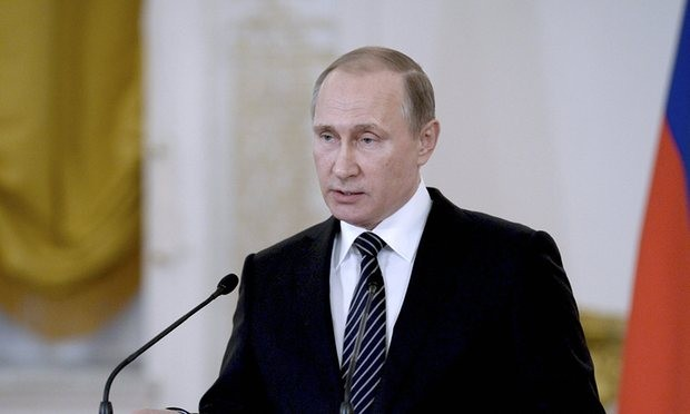 Vladimir Putin delivers a speech during a ceremony at the Kremlin for soldiers returning from Syria. Photograph: Reuters