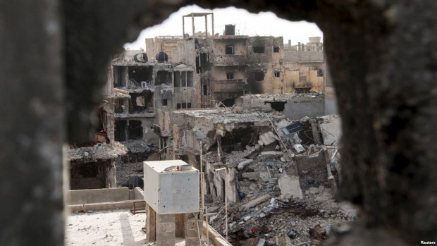 Damaged buildings are pictured after clashes between Dignity Operation forces and the Shura Council of Libyan Revolutionaries, in Benghazi.
