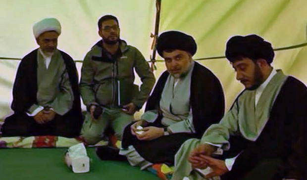 "A handout picture provided by the press office of Iraqi cleric Moqtada Sadr shows him (2nd from R) sitting in a marquee as he begins a sit-in protest inside Baghdad's fortified ""Green Zone"" on March 27, 2016. Sadr wants Prime Minister Haider al-Abadi to enact reforms tackling corruption and announce a technocratic government to replace the current cabinet of party-affiliated ministers. The symbolic move by the young Shiite cleric comes after thousands of his supporters have been camping outside the restricted area's entrances for more than a week. / AFP / MOQTADA SADR'S PRESS OFFICE / STR / === RESTRICTED TO EDITORIAL USE - MANDATORY CREDIT ""AFP PHOTO / HO / MOQTADA SADR'S PRESS OFFICE"" - NO MARKETING NO ADVERTISING CAMPAIGNS - DISTRIBUTED AS A SERVICE TO CLIENTS ==="