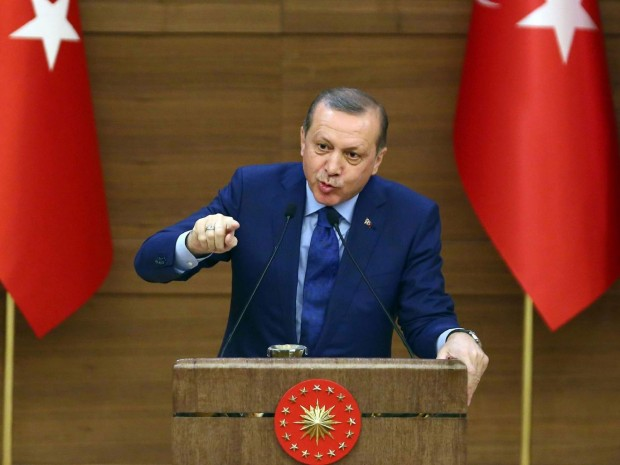 Turkish President Recep Tayyip Erdogan gestures as he delivers a speech during the mukhtars (local town government heads) meeting at the Presidential Complex in Ankara on March 16, 2016 AFP/Getty Images
