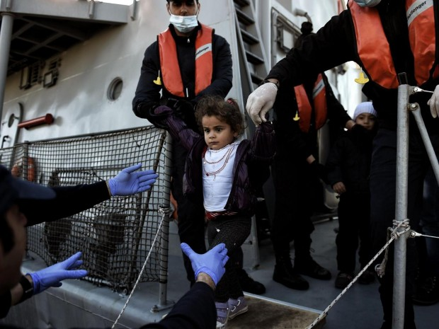 A migrant girl looks on upon arrival at the northern island of Lesbos after crossing the Aegean sea with other migrants and refugees from Turkey. AFP