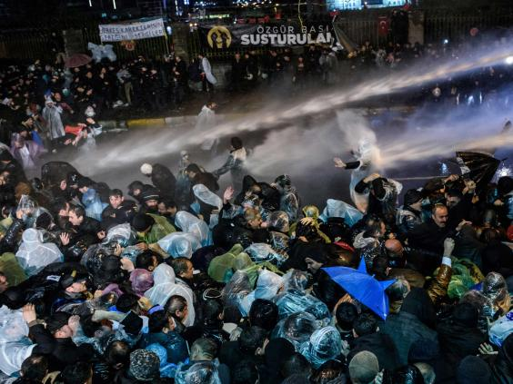 Turkish riot police use water cannon and tear gas to disperse supporters at Zaman daily newspaper headquarters