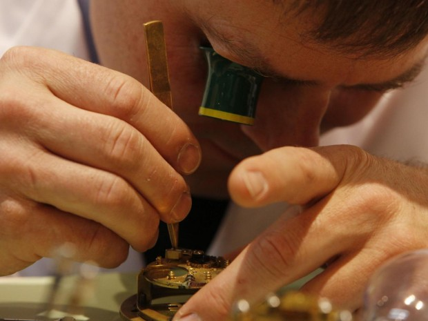A watchmaker works on a watch mechanism at the Baselworld trade show in Basel, Switzerland Michele Tantussi/Getty Images