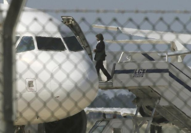An official boards a hijacked Egyptair A320 Airbus at Larnaca Airport in Larnaca, Cyprus, March 29, 2016. REUTERS/Yiannis Kourtoglou