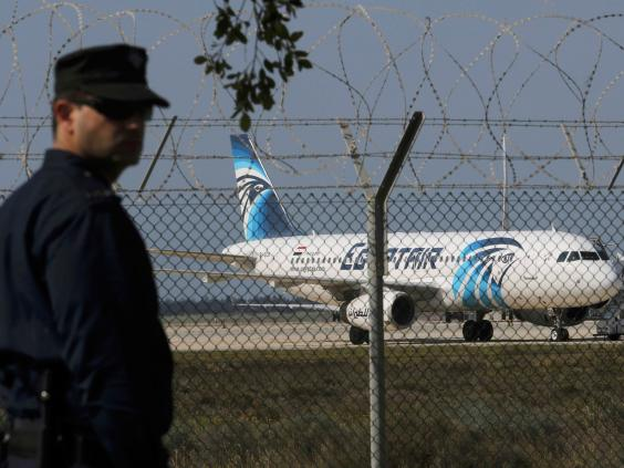 A policeman stands guard at Larnaca Airport near a hijacked Egypt Air A320 (Reuters)