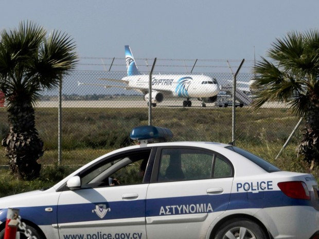 Police stand guard at Larnaca Airport near a hijacked Egyptair Airbus A320 Reuters