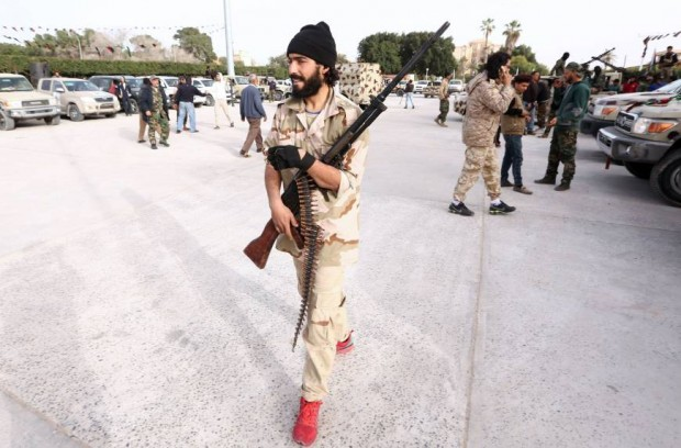 A Member of a brigade loyal to the Fajr Libya (Libya Dawn), an alliance of Islamist-backed fighters, takes part in a military parade following battles against the Islamic State (IS) group, in the city of Sabratha, west of the capital Tripoli, on February 28. | AFP-JIJI