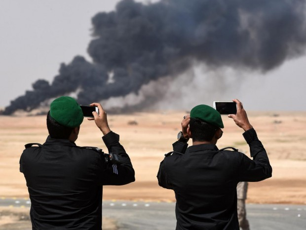 Saudi officers take photos of a joint military exercise between 21 Muslim nations in the Saudi desert Getty Images