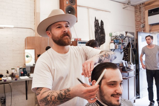 Garrett Pike cuts the hair of Nicholas Rozza at the Persons of Interest barbershop in Williamsburg, Brooklyn. Credit Alex Welsh for The New York Times